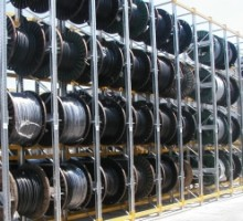 Racks for the cable-laid drums